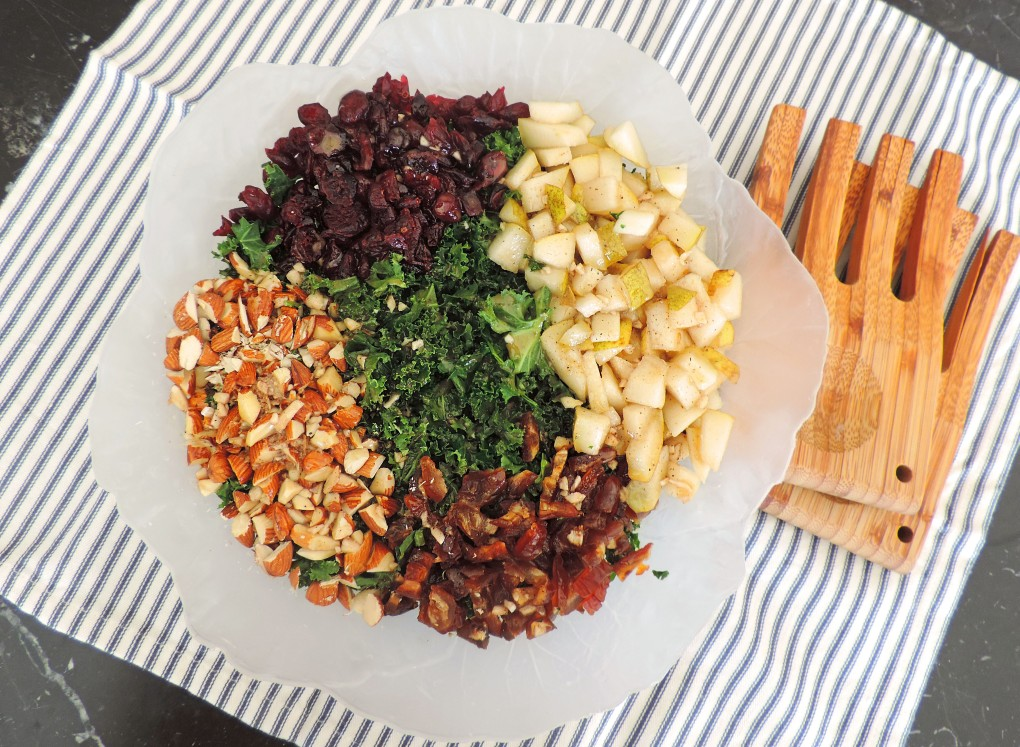 massaged kale salad with dates almonds pears and black currants 2