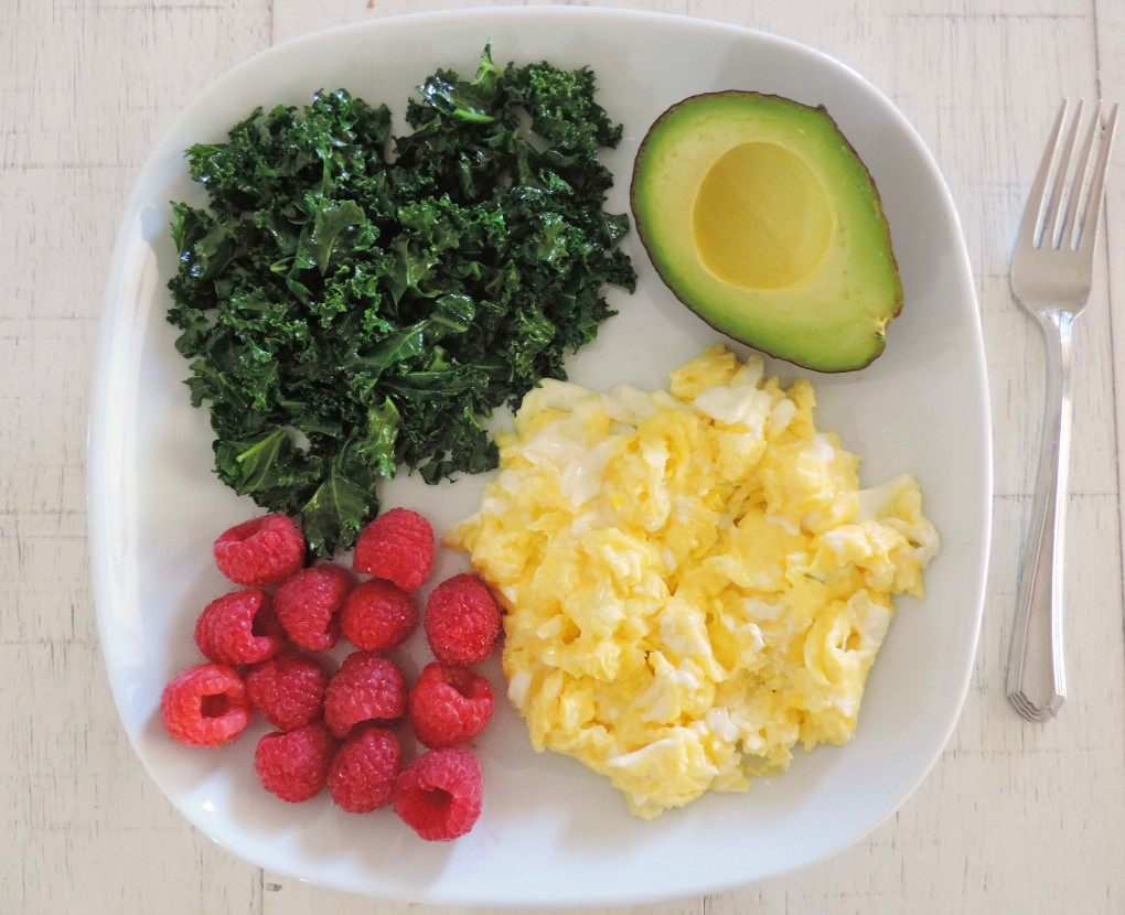 scrambled eggs, avocado, berries, and kale